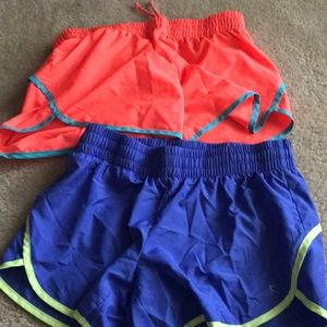 2 Danskin now shorts blue and orange size M